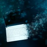 Computer Disintegrating To Show Data Destruction